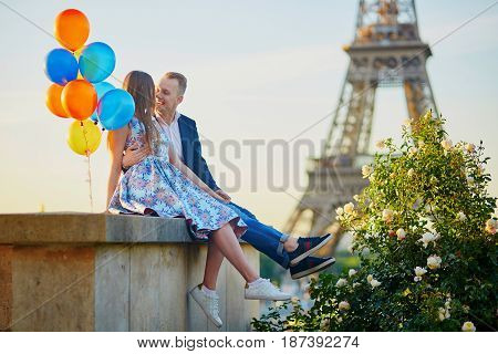 Romantic Couple With Colorful Balloons Near The Eiffel Tower