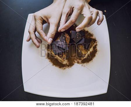 Hand Decorated With Women's Beautiful Chocolate Cake Closeup
