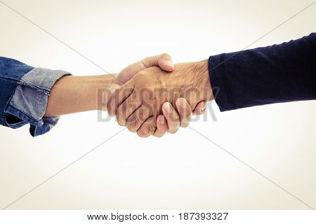 Hands of two men wearing casual clothes making handshake