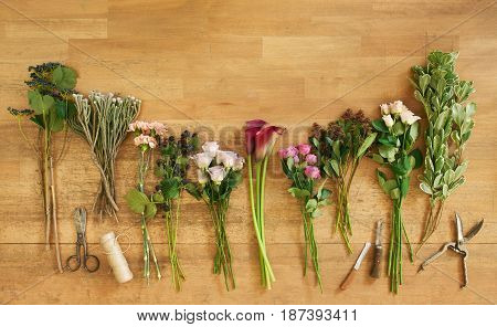 Flower shop background with copy space. Fresh roses for bouquet delivery, top view. Floral design studio, making decorations and arrangements.