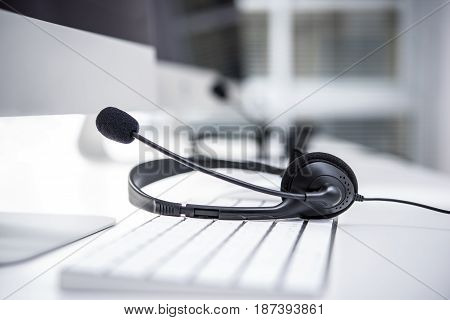 Headset with microphone on computer keyboard - call center concept