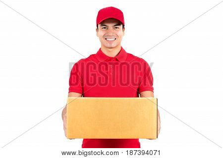 Smiling delivery man carrying a parcel box - isolated on white background