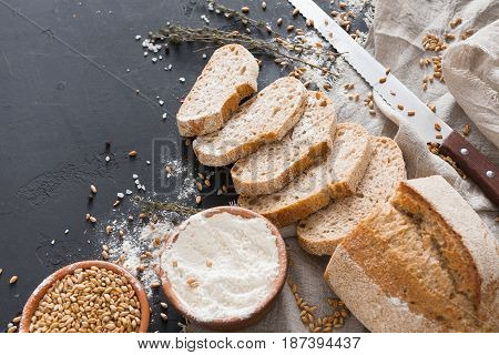 Bakery background, bread on black. Flour and grain with copy space