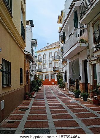 The narrow street in the center of Torremolinos la Carihuela district which is situated on the place of old fishing small village in a southwest part of the city. According to several versions the name Carihuela is translated as the fishing village.