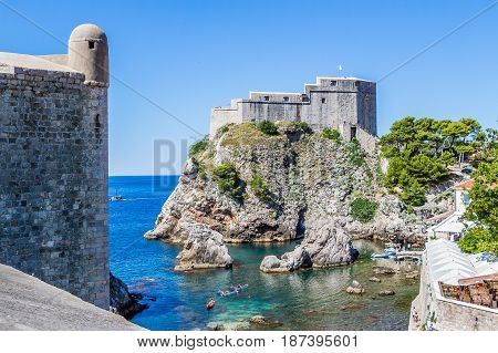 Sea Cove And City Wall Tower Under Fort Lovrijenac In Dubrovnik, Croatia