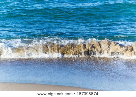 Small wave on the foreshore in Sardinia