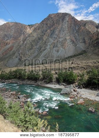 landscape of river inside rocks with mountains at horizon