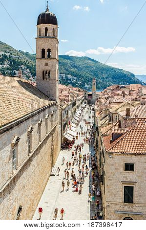 DUBROVNIK CROATIA - JULY 16th 2016: Franciscan Church and Monastery at Stradun (Placa) from Pile Gate to Clock Tower in the Old Town in a sunny summer day.