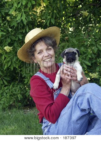 Smiling Woman Holding Pug