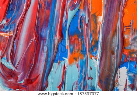 Liquid abstract paint strokes background. Fluid painting texture. Colorful mix of acrylic vibrant colors.