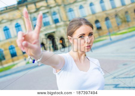 attractive girl pouting and showing v-sign