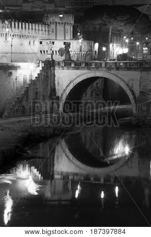 ROME, ITALY. JANUARY 09, 2015: Ponte and Castle Sant Angelo, bridge in Rome. Italy. Tiber river. Black and white. Once Aelian Bridge or Pons Aelius, meaning the Bridge of Hadrian, is a Roman bridge.
