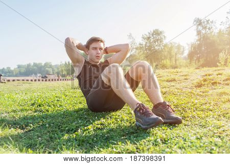 Fitness man doing sit ups and crunches exercising abdominal muscles