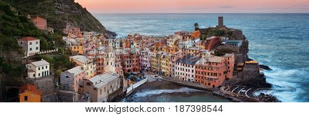 Vernazza with buildings on rocks over sea panorama view in Cinque Terre, Italy.