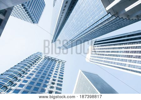 View of modern blue colored contemporary office city buildings