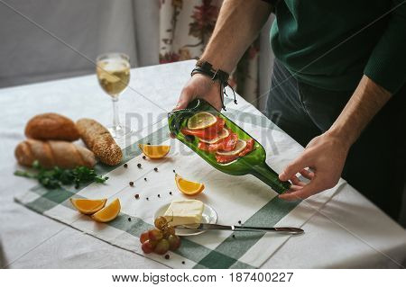 Only hands. Man finishing her plate and almost ready to serve at the table. Decoration of the table. Serving dishes. Eating in beautiful dishes. Russian feast