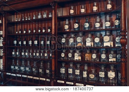 Kaunas, Lithuania - May 12, 2017: Shelf Of Vials With Retro Drugs In Old Apothecary Cabinet In Museu