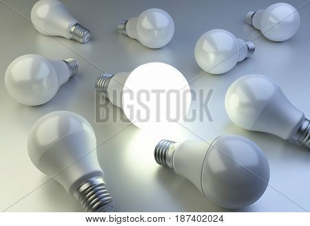 Bulbs are scattered on the surface and one bulb shining. The concept of individuality and leadership. 3d illustration on background.