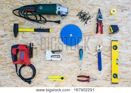 Industrial background with different tools on plywood repair concept