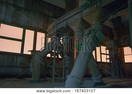 Old abandoned silo elevator with rusty equipment left