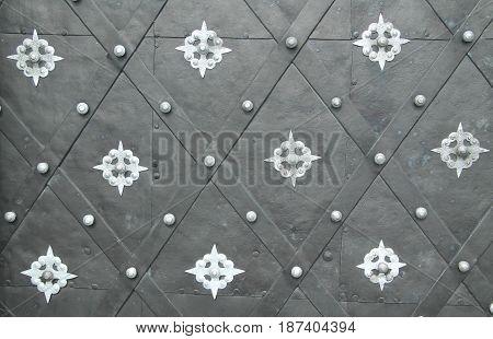 detail of beautiful decorated door of the basilica in Olomouc, Czech Republic