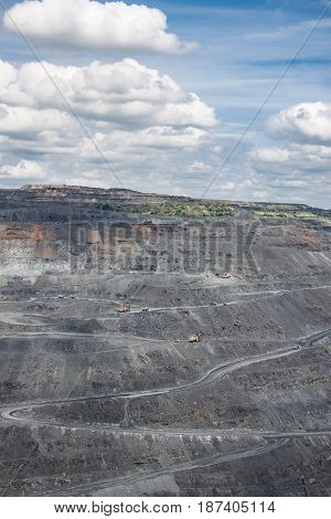 View to the iron ore mining with machinery