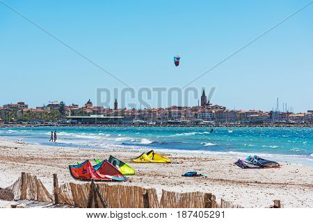 Alghero Italy - May 07 2017: Kite surfers in Alghero seafront