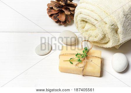 Massage or aromatherapy set: oil stones soap on white wooden stone