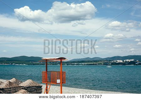 Rescue tower on background of sea and hills saving life on water concept