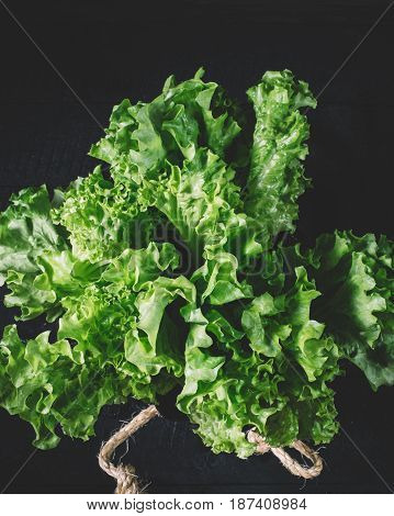 Green lettuce leaves on a background of white brick wall fresh healthy salad food on kitchen table space mock up dieting leaf vegan corn on wooden on space background organic plant crop close up