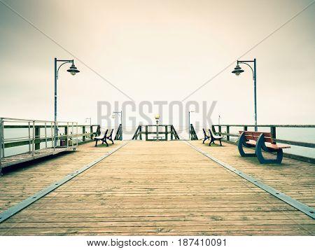 Seaside Telescope . Autumn Misty Morning On Wooden Pier