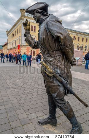 ALBA IULIA ROMANIA - APRIL 29 2017: Bronze statue with one Gentleman in Alba Carolina Citadel square depicting a medieval dressed and representing scenes of city life.