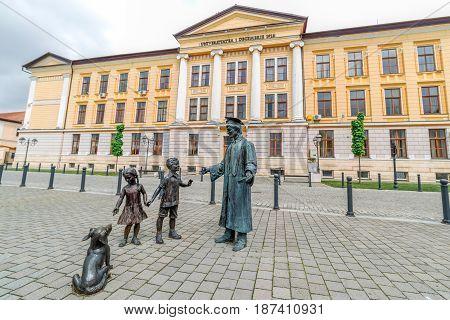 ALBA IULIA ROMANIA - APRIL 30 2017: Group of bronze statues in front of University of Alba Iulia in Carolina Citadel.