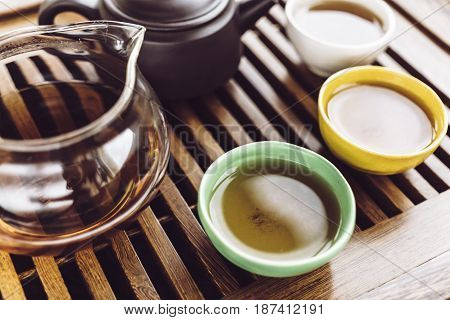 Chinese tea set, wooden teatable for tea ceremony background, Teapot and cups