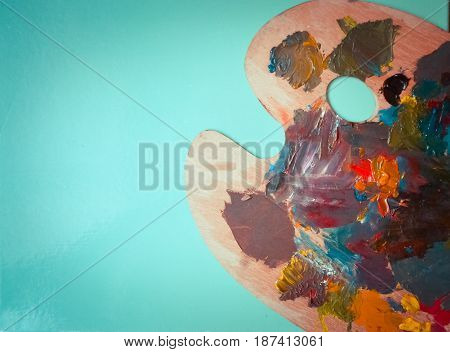 Isolated Palette with strokes of colors on a green background