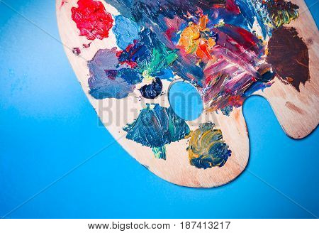 Isolated Palette with strokes of colors on a blue background