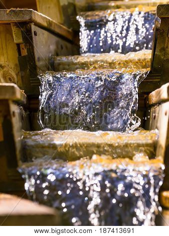Wooden staircase with flowing water waterfall, flowing water
