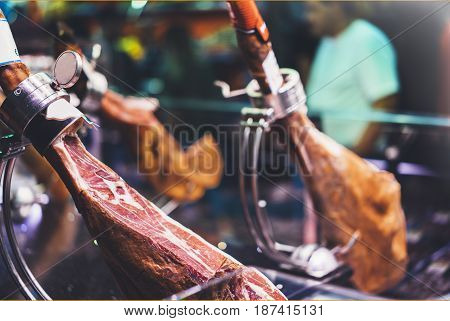 Spanish hamon in barcelona market jamon iberico in view black leg pork isolated traditional national spain meat in store serrano prosciutto food on background gastronomy bacon berian on cuisine