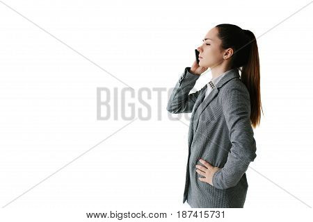 Businesswoman talking on the phone and giving directions. On a white background