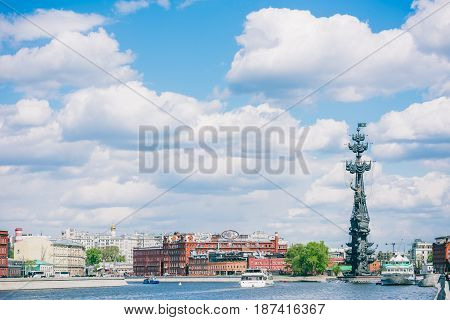 Moscow, Russia - May 13, 2017: wide view from Krymskaya embankment to the monument of Peter the Great and Krasniy Oktyabr chocolate factory. Passenger boats on the river