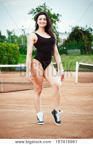 Beautiful Young Free Sexy Sports Girl Dressed In Bodysuit, Sneakers, With A Smart Ass And Long Legs,