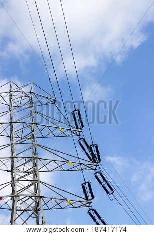 Construction of an electric pole. High voltage power line against the sky.