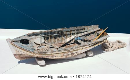 Old damaged rowing boat withpaddles and rope poster