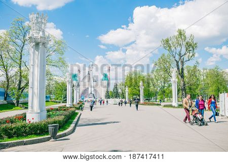 Moscow, Russia - May 18, 2017: people walking in the park of VDNKh - Exhibition of Achievements of National Economy. Alley near soviet spaceship Vostok
