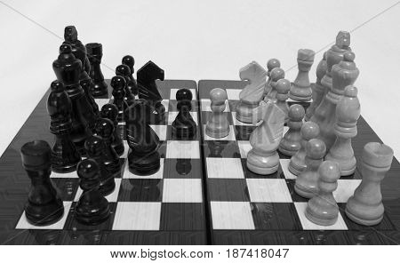 Chess. Beginning of the game.The chess pieces are placed on the chessboard. Black and white. Four knights debut.