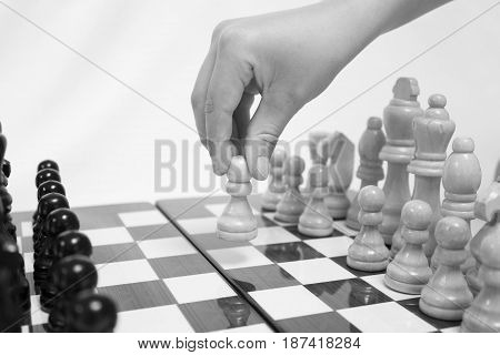 Chess. Beginning of the game.The chess pieces are placed on the chessboard. Black and white. First step.