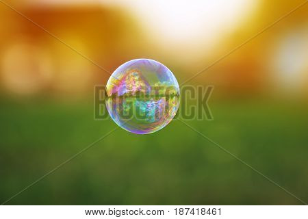 bright transparent soap bubble with a shimmering flying over a Sunny summer meadow