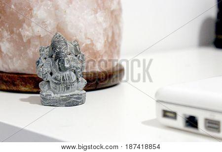 limestone carved ganesha figure with salt lamp