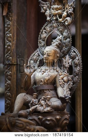 Ancient statue of a bodhisattva of Avalokiteshvara made of bronze in nevara style in the Golden Temple Lalitpur Kathmandu Nepal.