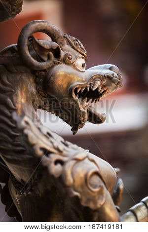 The growling mythical lion made of bronze in the ancient Buddhist temple Golden Templ Lalitpur Katmandu Nepal.